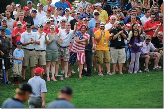DUBLIN, OHIO - OCTOBER 04: Fans cheer as U.S. Team captain Fred Couples walks by during the Day Two Four-Ball Matches of The Presidents Cup at the Muirfield Village Golf Club on October 4, 2013 in Dublin, Ohio. (Photo by Chris Condon/PGA TOUR)